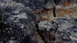 Although not in vicinity of a hydrothermal vent, iron oxide stained hydrothermally altered rock material is indicative of past hydrothermal activity i Image