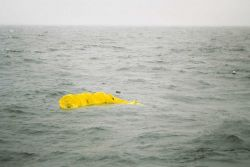 Deploying drogue attached to drifter buoy. Photo