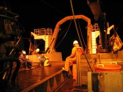 Retrieving bottom trawl. Photo