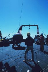 Preparing to launch a buoy during Gulf Stream eddy studies from the stern of the NOAA Ship ALBATROSS IV. Photo