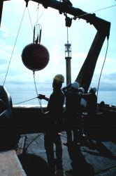 Buoy with tethered current meter being launched during Gulf Stream eddy studies from NOAA Ship ALBATROSS IV. Photo