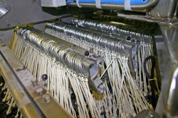 A commercial longline rack rigged with commercial gear ready to be baited on a commercial fishing vessel in the Gulf of Alaska. Image