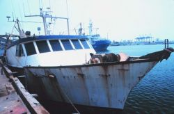 A muti-purpose fishing vessel at Terminal Island next to the Heinz Plant Image