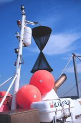 The triangular cones are daymarks to indicate vessel is fishing Photo
