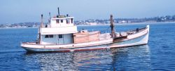 An oyster boat dredging Image