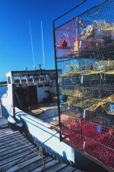 A blue crab fishing boat loaded with pots and ready to go to work. Image