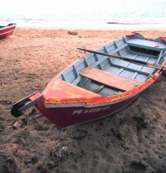Small scale fishing boats on the beach Photo