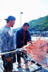 Fishermen mending nets at St Photo