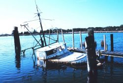 Even boat's die - once a cherished workboat of a North Carolina crabber Photo