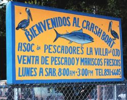 A sign advertising the Fishermen's Association of Crashboat Image