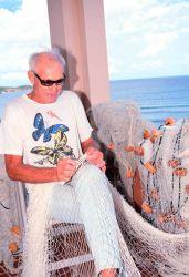 An ancient mariner mending his nets Photo