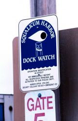 Sign warning would be thieves and trespassers of the Squalicum Harbor dock watch Photo