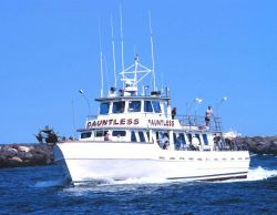 A recreational fishing boat enters Manasquan Inlet after a day of fishing. Image