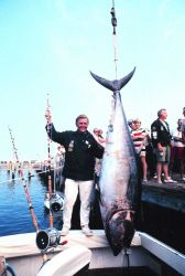 A proud fisherman with his catch at the United States Atlantic Tuna Tournament Image