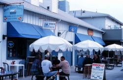 Outdoor seating for seafood restaurant Photo