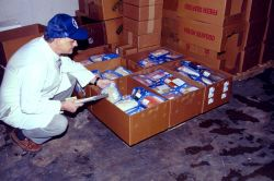 Labeled packages are boxed and inspected at a Baltimore plant before shipment to local markets. Photo