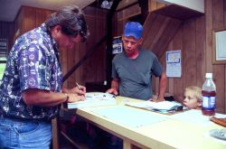 Mississippi fisheries agent checks required documentation at a Pascagoula bait shop. Photo