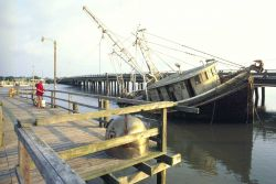 Derelict fishing boat left at the pier to rot Photo