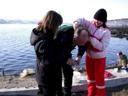 Biologists of MMBI help to dress diver before diving Photo