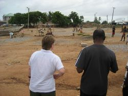In the foreground, NOAA fisheries scientist Teresa Turk and Ghanaian observer, Richmond Quartey, looking at the fish drying operation outside Tema, Gh Photo