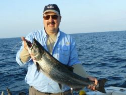 Sport fisherman holding Atlantic salmon Photo