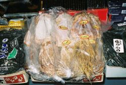 Packages of dried squid in the center and nori, porphyra, on the sides for sale that the Shiogama market in Japan. Photo