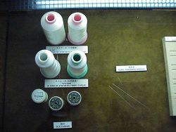Examples of nulon, tettron, and silk threads used in the stringing of pearls Photo