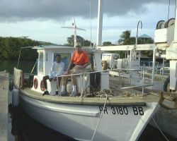 Boat used by staff to transport of cobia juveniles (Rachycentron canadum) to offshore cage at Culebra Island, Puerto Rico Photo