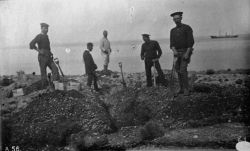 Kitchen midden at Elizabeth Island, Strait of Magellan as excavated by the Albatross party with the Albatross at anchor, 1888. Photo