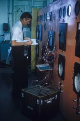 An engineer at the Gloucester Technological Laboratory tests newly developed plastic container for shipping iced fresh fish long distances Photo