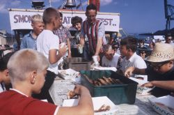 At the annual fish day at Port Washington, youngsters participate in a smoked- fish eating contest. Photo