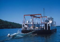 A converted ferryboat is used in the Potomac River by the Virginia Institute of Marine Science to test the efficiency of a midwater trawl in catching  Photo