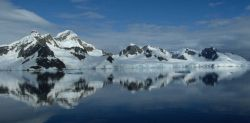 An unusually calm day in the South Shetland Islands, with mirror-like waters. Photo