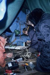 Polish electronics technician Emil Ociepka, John Wormuth and John Green work under a makeshift tent on the deck of the R/V Profesor Siedlecki, termina Photo