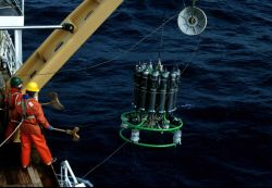 A conductivity-temperature-depth (CTD) is deployed from the fantail of the R/V Surveyor. Photo
