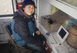 Antarctic researcher Lisa Hiruki-Raring downloads data in the observation blind at North Cove, Seal Island. Photo