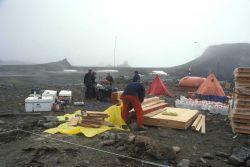 AMLR scientists build the Cape Shirreff field camp. Photo