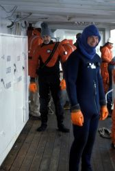 George Watters dons a survival suit for protection from icy Antarctic waters. Photo