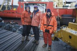 Polly Penhale (NSF), Rennie Holt and AMLR scientists at Palmer Station with R/V Polar Duke in background. Photo