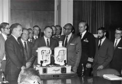 Wally Hickel, Secretary of the Interior, with other dignitaries and Tektite aquanauts inspecting a model of the Tektite II manned undersea habitat. Photo