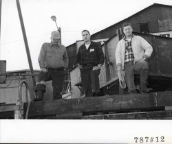 Master of the LEMES on left with employees of the Everett Fish Company Photo