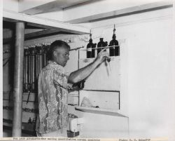 Scientist making quantitative oxygen analysis of sea water on board the Fisheries Research Vessel HUGH M Photo