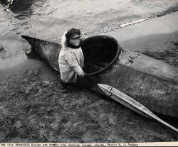 Eskimo child with bubble gum and kayak Photo