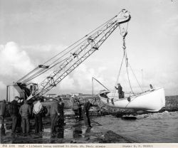 Lifeboat being launched to obtain supplies from FWS ship DENNIS WINN Photo
