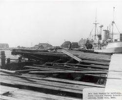 Main dock damaged at Woods Hole BCF Biological Laboratory by Hurricane Carol. Photo
