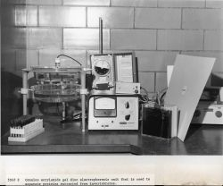 Canalco acrylamide gel disc electrophoresis unit that is used to separate proteins extracted from invertebrates. Photo