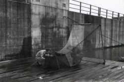 One of several large fyke nets used to catch seaward migrating fingerlings at Bonneville Dam Photo