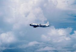 NOAA P-3 N43RF in flight Photo