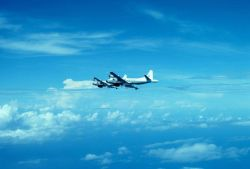 Both NOAA P-3's flying to a mission. Photo