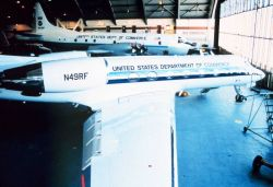 Gulfstream IV and P-3 in NOAA hangar at MacDill AFB Photo